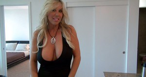 Stunning mature babe with big tits Sandra Otterson reveals her housewife ass