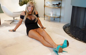 Milf housewife Sandra Otterson poses in high heels and tight skirt