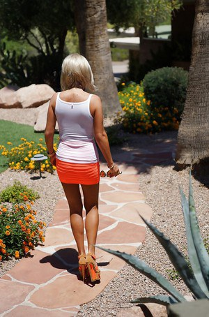 Milf housewife Sandra Otterson takes part in an outdoor posing scene