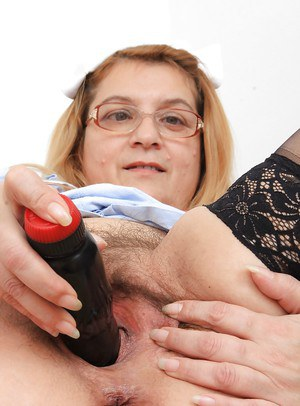 Mature fatty Jitule demonstrates her hairy pussy in her uniform