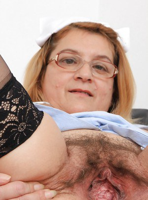 Mature fatty Jitule shows off in her nurse uniform and glasses