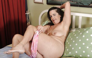 Brunette granny Tia takes part in an undressing scene, showing her tits