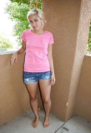 Undressing session features teen babe in jeans shorts Lacey