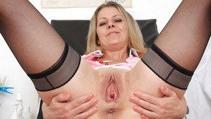 Mature nurse in sexy uniform and stockings Liba shows her pussy