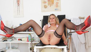 Uniformed nurse Liba reveals her mature shaved pussy in high heels
