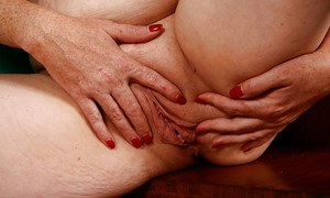 Shaved pussy and fatty ass of mature cutie Cinna Page shown in close up