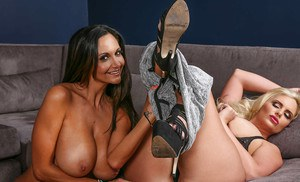 Lesbian ladies with large tits Ava and Phoenix are kissing each other