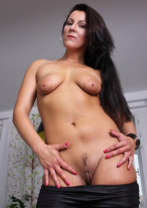 Sweet and amazing brunette MILF Valentina is undressing her body