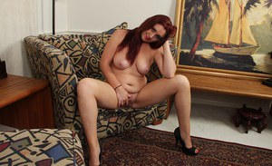 Undressing and masturbating session features milf babe Phoebe Brown