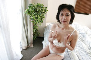 Asian milf Michiyo Fukumoto demonstrates her tiny tits and hairy pussy