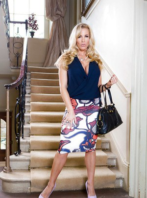 Blonde milf Rebecca Moore demonstrates her big tits and long legs