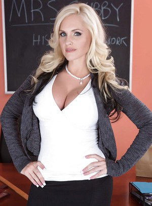 Blonde milf babe Alena Croft shows off her ass in a tight skirt