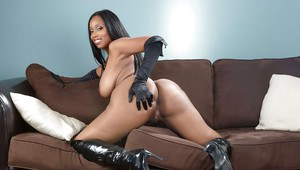 Ebony milf Codi Bryant teases her big tits and tight ass in high heels boots