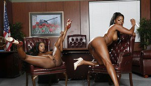 Office posing scene with Ebony lesbians Diamond Jackson and Jasmine Webb