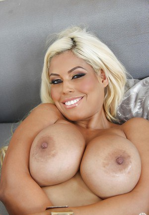 Blonde milf babe with big tits Bridgette B demonstrates her ass
