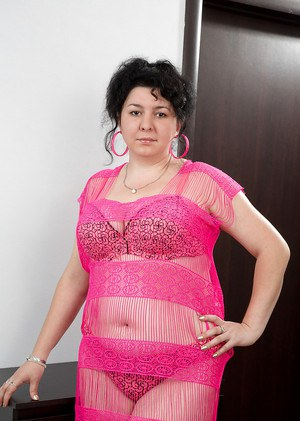 Shaved pussy of a mature fatty Gulya shown in pink lingerie