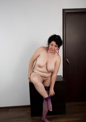 Close up posing of a mature fatty brunette Gulya in tight stockings