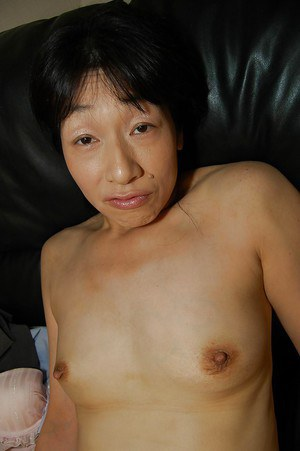 Tiny tits Asian milf Chie Kaneko reveals her hairy pussy while masturbating