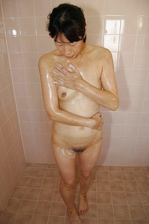 Masturbating Asian milf Chie Kaneko teases her hairy pussy in shower