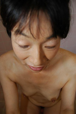 Tiny tits Asian milf Chie Kaneko dose handjob to her man in shower