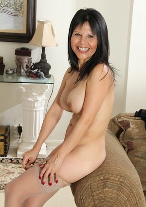 Mature brunette Marcy Darling shows off her big tits in close up
