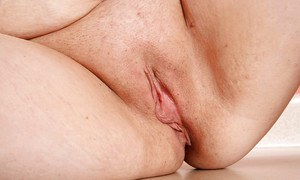Mature fatty Cinna Page demonstrates her saggy tits and shaved pussy