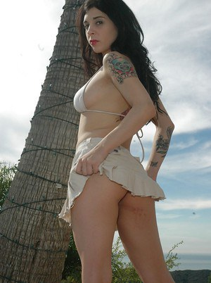 Outdoor upskirt posing from an amateur babe with tattoos Joanna Angel