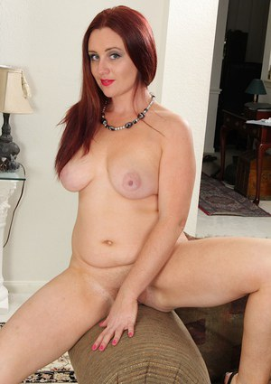 Big tits babe Phoebe Brown shows off her mature ass while undressing