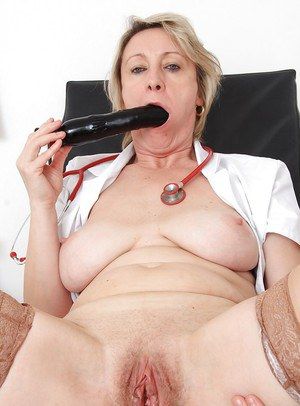 Big tits mature Ester reveals her hairy pussy in a uniform