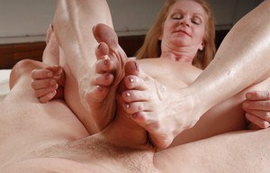 Sweet granny with long legs and saggy tits Tiffany dose a blowjob