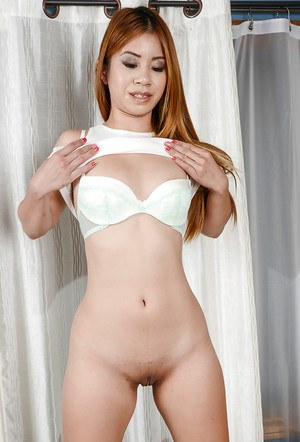 Amateur babe Asia Zo teases her Asian pussy and ass in close up