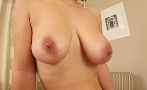 Mature babe Luci Angel reveals her big tits and shaved pussy