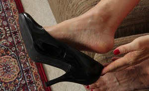 Close up foot fetish scene features mature lady in lingerie Lisa Cognee