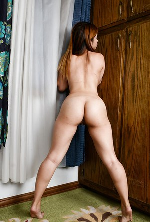Close up amateur posing scene with Asian cutie Asia Zo showing her ass