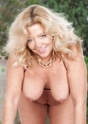 Close up outdoor posing from a fatty mature Karen Summer at the pool