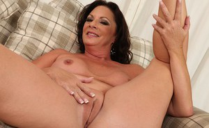 Upskirt masturbating scene features a big tits mature babe Margo Sullivan