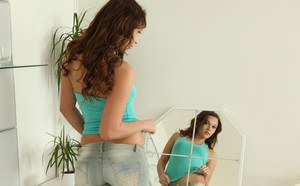 Brunette babe Daphne is pissing right in her tight jeans pants