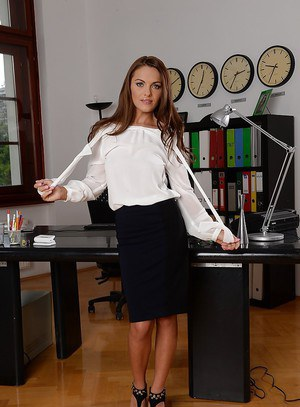 European babe Dominica Fox demonstrates her big tits in office