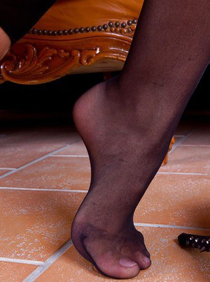 Foot fetish scene features lesbian girl with long legs in stockings Alexa Tomas