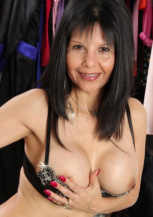 Mature chick with brunette hair Marcy Darling reveals her big tits