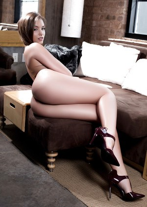 Posing scene features a centerfold babe in high heels Mandy Kay