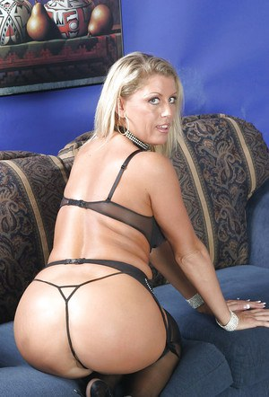 Mature babe Chelsea Zinn shows off her big tits in her black stockings