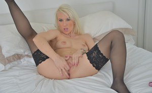 Milf babe with blonde hair Evey Kristal shows off in her stockings
