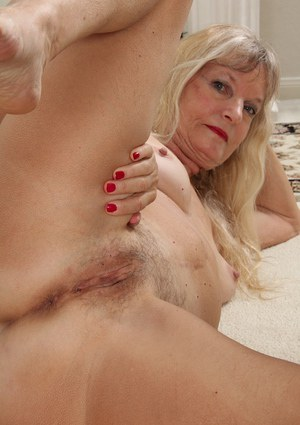 Undressing scene in close up features a big tits granny Lisa Cognee