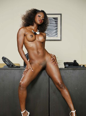 Curly-haired babe Ashley Sinclair shows off her chocolate body