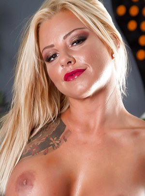 Busty babe Britney Shannon shows her tattoos and nice hard nipples
