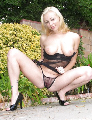 Bleached Adrianna Nicole plays with her lovely boobies outdoors