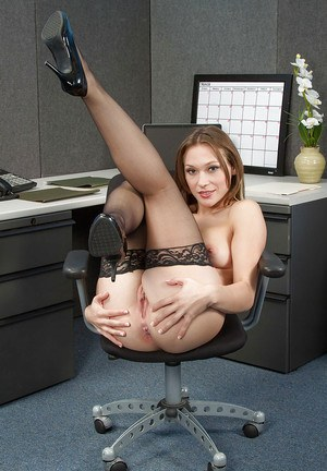 Office beauty Callie Calypso poses in a sexy black stockings