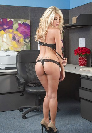 Office blonde Kayla Kayden demonstrates her nice natural tits