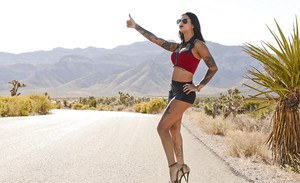 Tattooed brunette Bonnie Rotten is posing naked in the sunny day